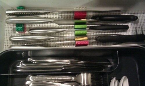 Knives in a drawer, held upright with Lego